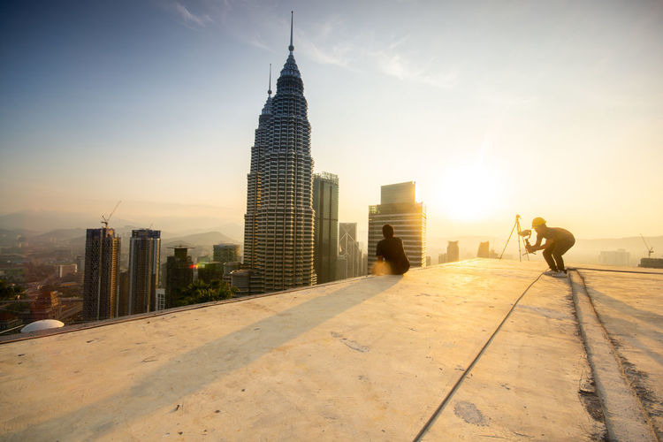 Kuala Lumpur skyline sunrise Architecture Building Exterior Built Structure City Sky Office Building Exterior Building Real People Skyscraper Tower Nature Tall - High Sunset Office Sunlight Modern Full Length People Men Lifestyles Outdoors Cityscape Financial District  Spire