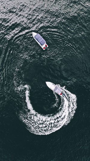 Aerial view of motorboat in sea