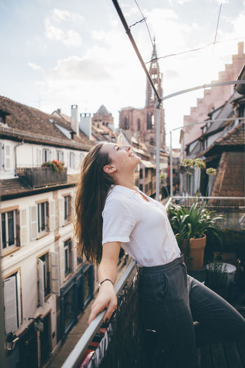 Afternoon Cityscape France Happiness Happy Houses Sightseeing Strasbourg Terrace Travel Woman Balcony Cheerful Girl Goldenhour Portrait Relax Roadtrip Sun Sunset Village Fresh On Market 2017 Inner Power