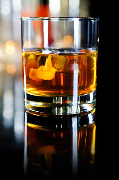 Glass of whiskey with ice cubes and fruits Golden Ice Light Rum Alcohol Alcoholic Drink Bar Booze Brandy Close Up Close-up Drink Drinking Glass Glass Highball Highball Glass Indoors  No People Nobody Refreshment Restaurant Scotch Shot Glass Spirits Whiskey