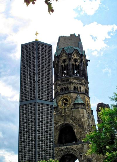 Two Towers Berlin Photography Gedächtniskirche In Memory Streets Of Berlin Two Towers Architecture Belief Berliner Ansichten Building Exterior Built Structure Cloud - Sky Day History Low Angle View No People Old And New Architecture Outdoors Place Of Worship Side By Side Spirituality Tall - High The Past Tower Travel Destinations