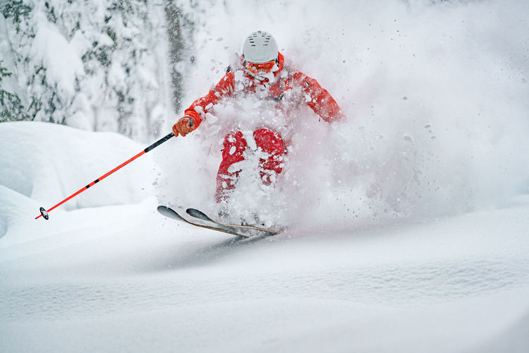 Adult man skiing in deep powder snow in the backcountry, werfenweng, austria