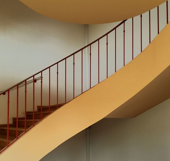 Low angle view of stairs by the wall