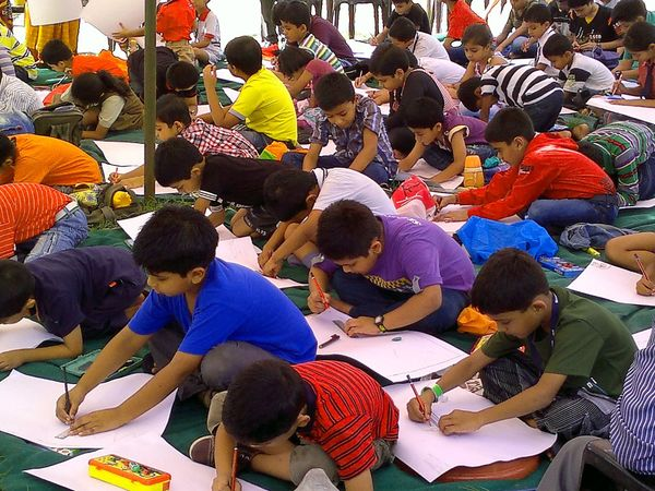 Art, Drawing, Creativity ArtWork At School Busy Children Casual Clothing Childhood Children Children Photography Colors Colourful Competition Competition Day Cute Drawingtime Elementary Age Fun India Innocence Looking Away Many Shades Of Colors Person Real People School Life  The Color Of School