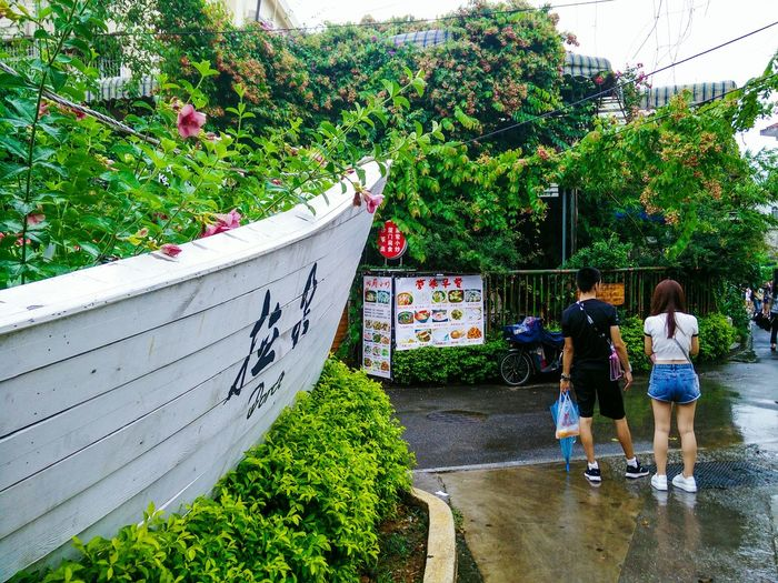 Outdoors Footpath Green Color Full Length Person Togetherness Day Wet Green Color Raining Day People Street Photography Street EyeEm Plant Hi! Taking Photos Hello World Hello Hanging Out EyeEm Gallery Leisure Activity Urban Lifestyle Eyeemphoto EyeEm Best Shots
