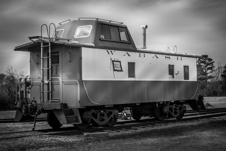 Wabash Caboose in B&W with Complex Lighting Abandoned Architecture Bicycle Building Exterior Built Structure Car Cloud Cloud - Sky Cloudy Day Land Vehicle Mode Of Transport Outdoors Parked Parking Road Sky Stationary Street Transportation