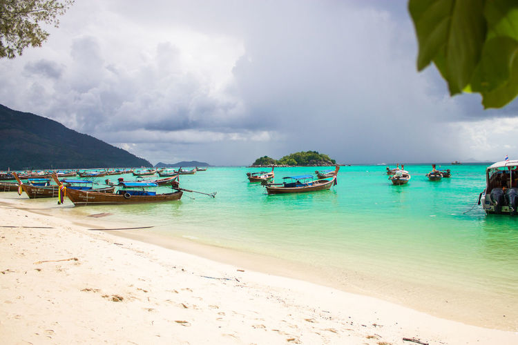 Beach Beauty In Nature Cloud - Sky Day Fishing Boat Horizon Over Water Incidental People Land Mode Of Transportation Moored Nature Nautical Vessel Outdoors Sand Scenics - Nature Sea Sky Tranquil Scene Tranquility Transportation Tree Turquoise Colored Water