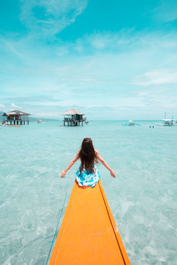 Chilling EyeEm Selects Philippines Water Sky Real People Lifestyles Sea One Person Leisure Activity Rear View Beauty In Nature Nautical Vessel Day Women Transportation Nature Scenics - Nature Land Trip Blue Outdoors Hair Turquoise Colored Hairstyle