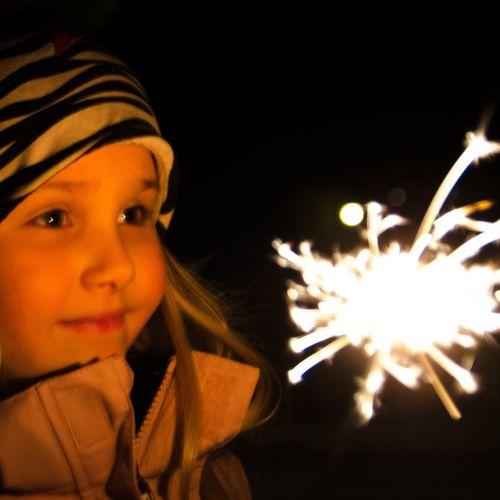 Portrait of girl in illuminated park at night