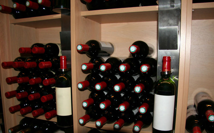 wine bottles in a rack - saint-emilion, france Alcohol Blank Label Bordeaux Bottle Burgundy Cellar Food And Drink For Sale France In A Row Indoors  Large Group Of Objects Merlot No People Red Retail  Saint-Emilion Shop Store Wine Wine Bottle Wine Cellar Wine Rack Wine Store Winery