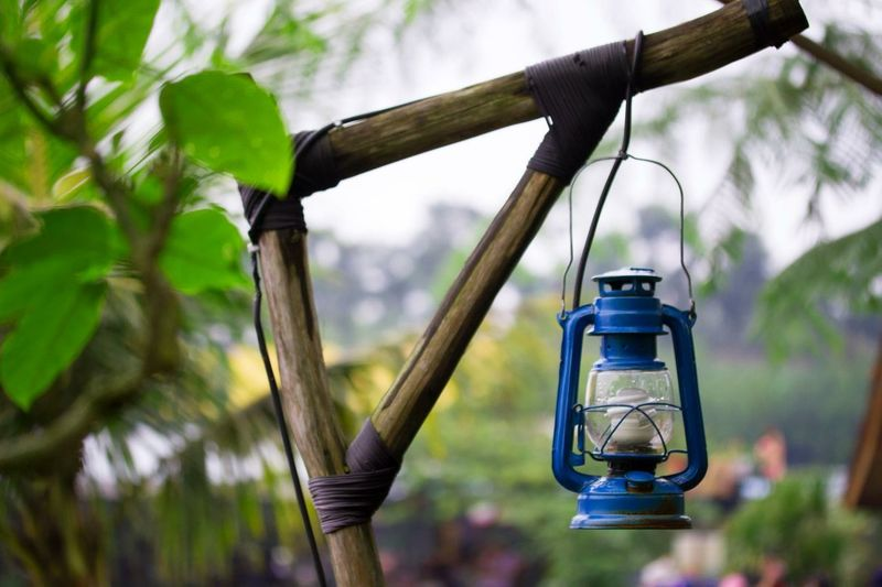 Old Oil Lamp Hanging From Bamboo