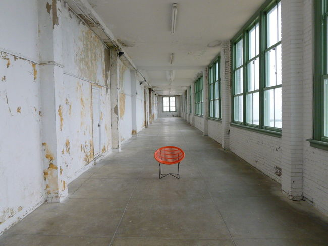 Deteriorating Building Architecture Asbury Park Concrete Floor Convention Center Corridor Day Empty Green Windows Indoors  No People Orange Chair Pealing Paint White Walls