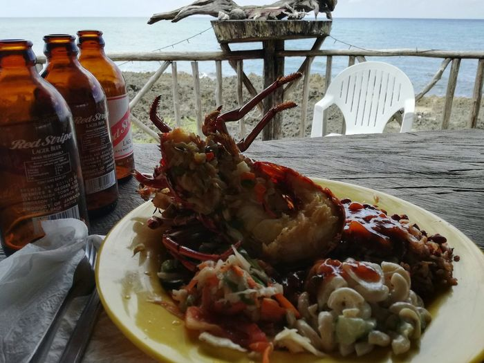 Food Food And Drink Lobster And Beer Young And Wild Island Islandlife Caligos Jack Bar Jamaica Dinner Time Take Photos Summer Eyem World Hearth Respect Nature Eyemphotos Travel Exotic Tropical Explore Coulture Travel Destinations Red Stripe Beer