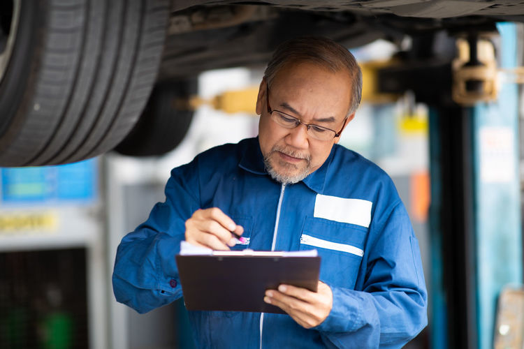 Mid adult man working at auto repair shop