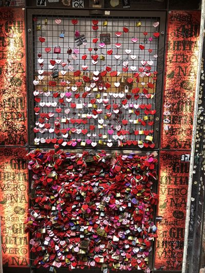 Collection of love locks on Juliet's House in Verona, Italy Verona Italy Juliet's House Locket Love Locks Multi Colored Red Red Color Collection No People