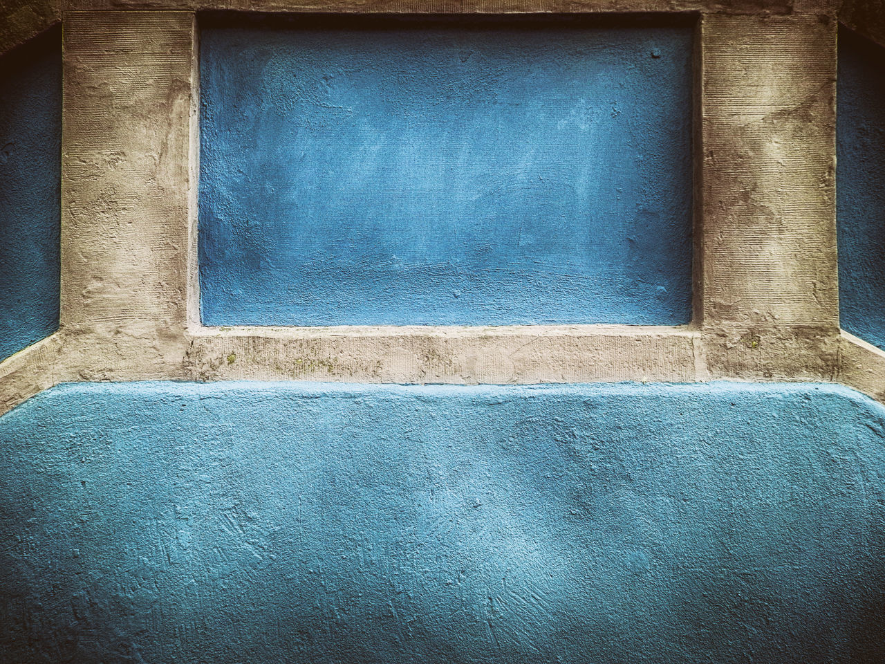 FULL FRAME SHOT OF BLUE WALL WITH WINDOW
