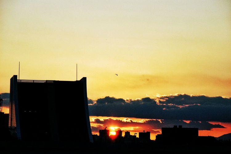 Silhouette of buildings at sunset