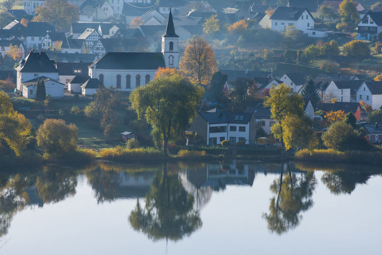 Church Schalkenmehren Urban Scene Architecture Autumn Beauty In Nature Building Exterior Built Structure City Eifel Germany High Angle View Lake Nature No People Outdoors Reflection Scenics Town Tranquility Village At Lake Water Waterfront