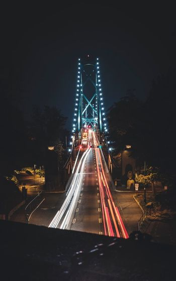 High Angle View Of Light Trails On Bridge At Night