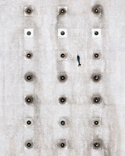 Aerial view of man walking on street