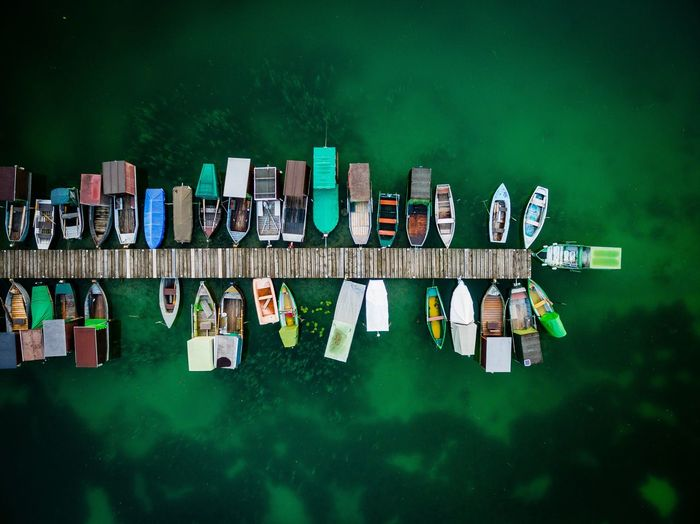 High angle view of boats moored at harbor on sea