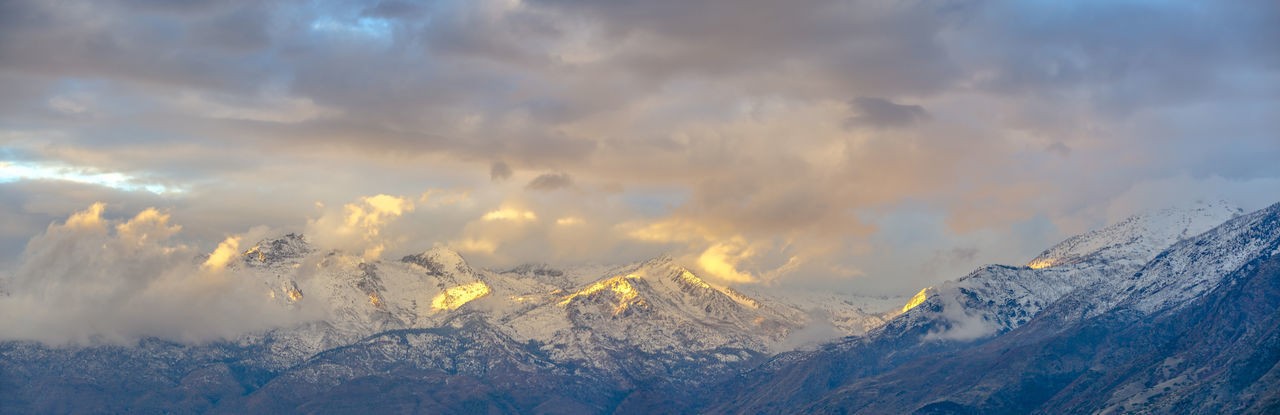 Panoramic view of snowcapped mountains against sky