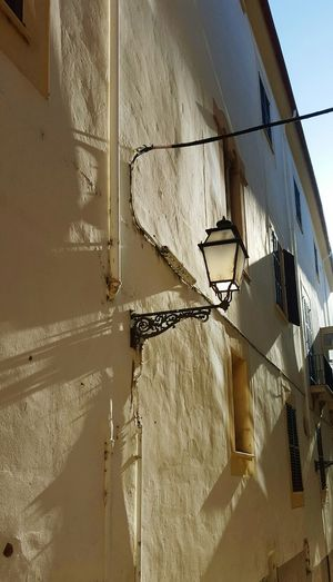 Outdoors Streetlight Old Streetlight Shadows On The Wall Mediterranean  Power Lines House Wall Warm Colors Sunny Day Windows