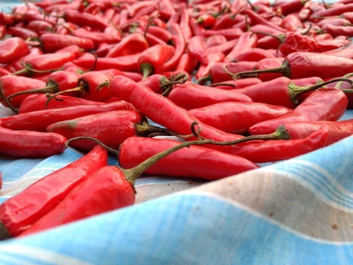 Close-Up Of Red Chili Pepper On Fabric
