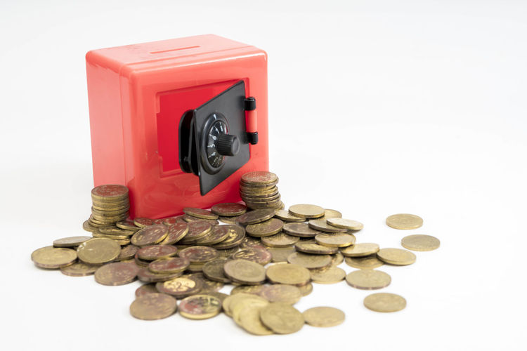 Red safe box and coins White Background Finance Coin Studio Shot Business Indoors  Currency Large Group Of Objects Wealth Savings Still Life No People Container Investment Close-up Stack Cut Out Copy Space Red Metal Economy