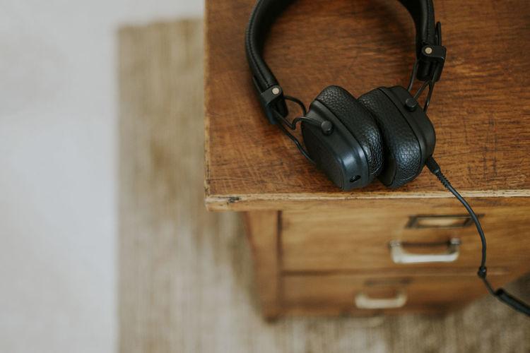 Music Technology Headphones No People Close-up Selective Focus Black Color Audio Equipment Wood Desk Style Lifestyles