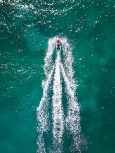 Aerial view of sailing in jet boat on sea