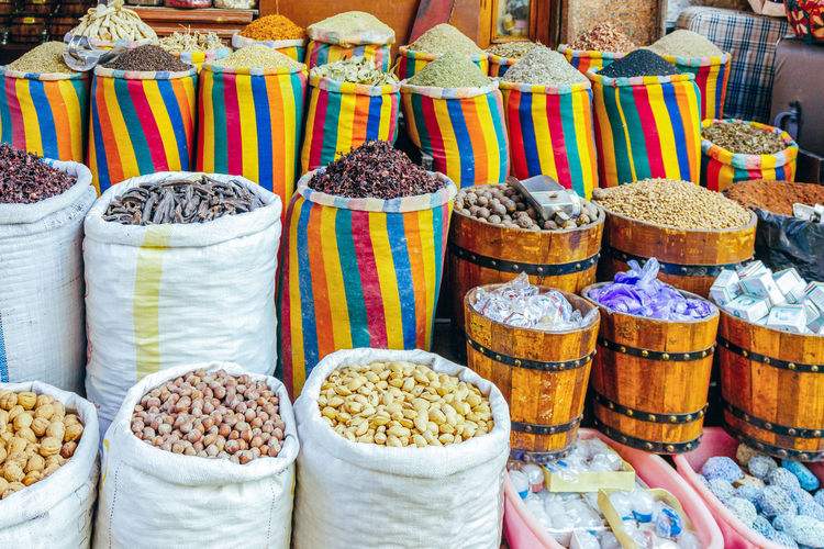 Close-Up Of Various Spices And Nuts In Sack At Market Stall