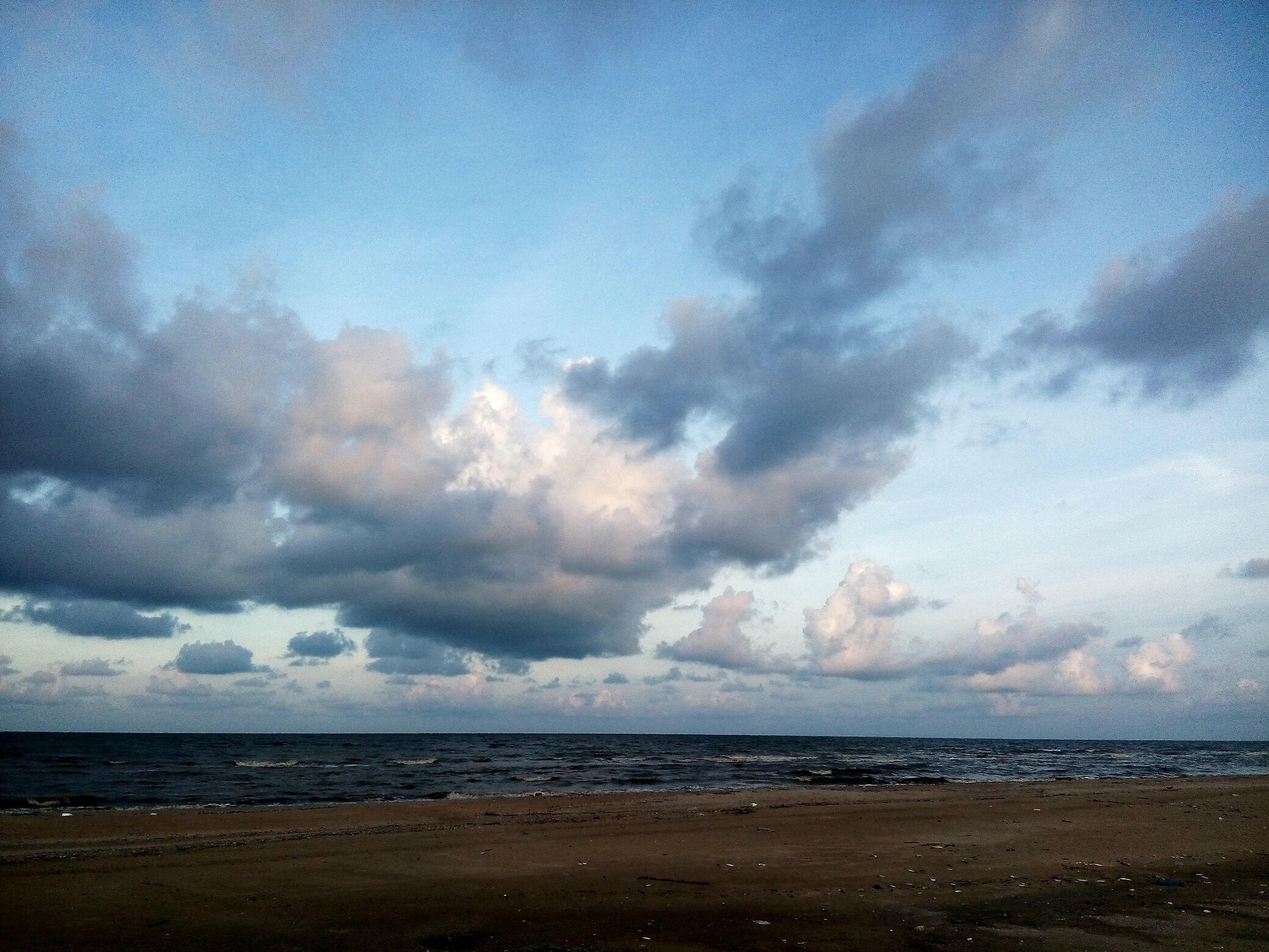 sea, beach, horizon over water, cloud - sky, water, sky, scenics, beauty in nature, sand, no people, outdoors, nature, sunset, travel destinations, wave, day