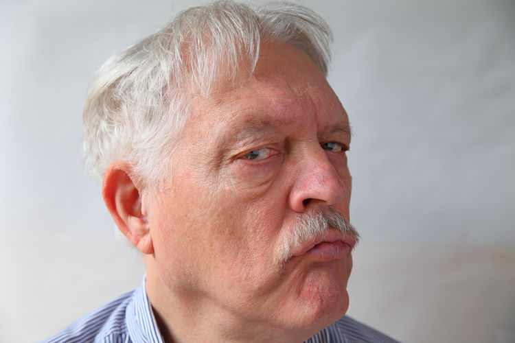 Close-up portrait of man looking away