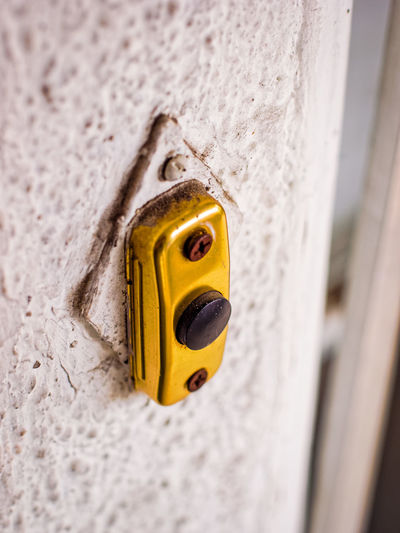 Close-up Day Door Doorbell Focus On Foreground Macro Photography Metal No People Selective Focus Still Life Textures And Surfaces Yellow