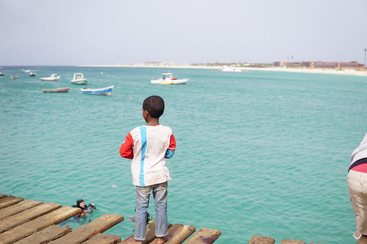 Some of my favorite pictures from my recent holiday to Sal. Atlantic Ocean Cape Verde People Watching Pier Beach Child Childhood Innocence Looking At View Nature Nofilter Outdoors People Photography Sea Water