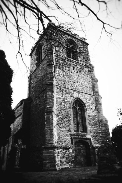 Architecture Bare Tree Black And White Blackandwhite Building Exterior Built Structure Cemetery Church Clear Sky Day English Church Gravestone History Low Angle View No People Old Ruin Outdoors Place Of Worship Religion Sky Spirituality Spooky Spooky Atmosphere Spooky Church Graveyard.. Tree