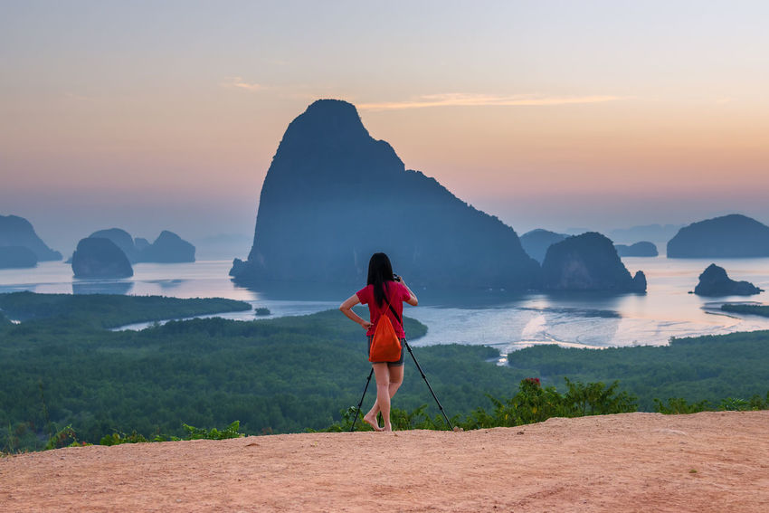Sunrise at Samet Nang She View Point at Phang Nga province in Thailand. Beautiful Blackground Camping Family Mangrove Forest Morning National Park Samet Nang She Silhouette Travel Twilight Yoka Amazing Family Time Landscape Milky Way Milky Way Galaxy Nature Phang Nga Bay Thailand Seascape Star Sun Tent View Point Women