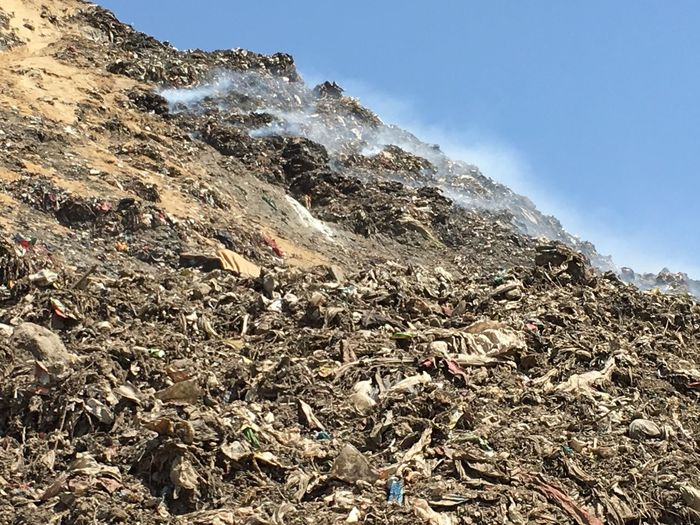 Smoke rise as garbage burns spontaneously in garbage mountain in New Delhi Burning Delhi Garbage Garbage Mountain Landfill Okhla Dump Pollution In My World Rubbish Dump Spontaneous Ignition Toxic Smoke Urban Problem Urban Waste Urbanisation