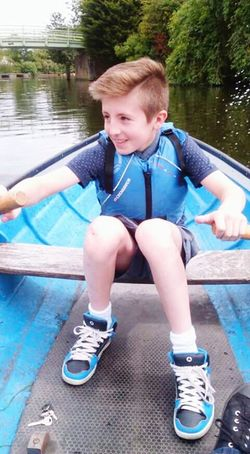 Youth Of Today Rowing Rowing Boat River Happy Bridge Boy Young BoyLife Jacket Hairstyle Happy Boy One Boy A Boy Rowing Boats