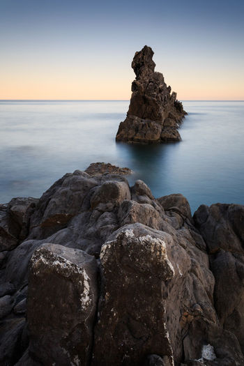 Sea Rock - Object Horizon Over Water Beach Sunset Landscape Scenics Nature Beauty In Nature Outdoors Sky Cliff Summer Travel Destinations Water No People Wave Day Clear Sky Italy🇮🇹 Long Exposure Stones Rocks Beauty In Nature