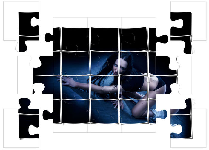 Real People Indoors  Digital Composite Sitting Full Length Shape Adult Lifestyles Men Wall - Building Feature Design Architecture Flooring Black Color Built Structure Tile Pattern Puzzle  Woman