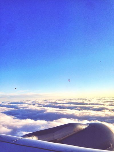 In The Sky Flying through the Fluffy Clouds Beautiful Moments The Sun Shines Bright Over Here Feels Like Heaven Satisfaction Peaceful From An Airplane Window View From An Airplane