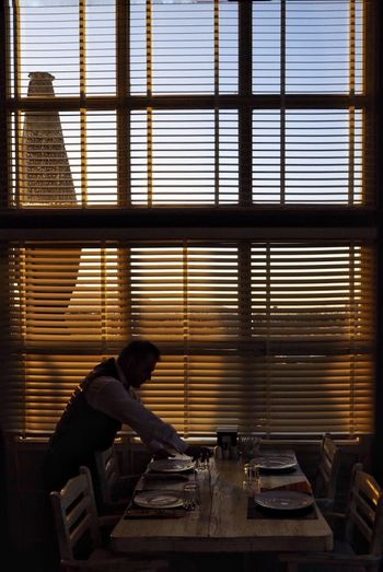 restaurant and sunshine Restaurant EyeEmNewHere Sunset Sunlight #personel Garson Meal Real People Day Manual Worker One Person Indoors