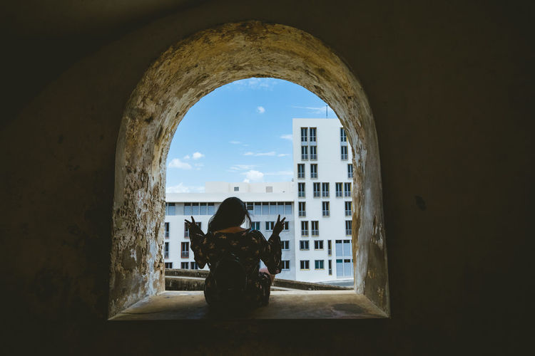 Exploring Peace Puerto Rico Travel Traveling Arch Architecture Building Built Structure Day Full Length Indoors  Lifestyles Nature One Person Real People Rear View Relaxation Sitting Sky Travel Destinations Urban Window Windows Women The Troublemakers My Best Photo International Women's Day 2019