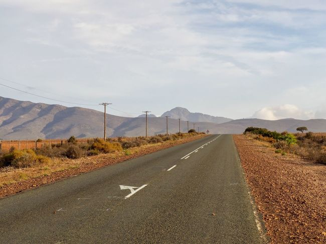 A road Beauty In Nature Day Landscape Mountain Mountain Range Nature No People Outdoors Road Road Marking Scenics Sky The Way Forward Transportation White Line