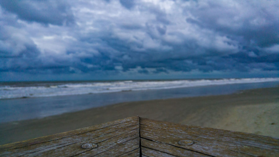 Wood deck on the beach Table Wood Deck Sea Water Beach Wood - Material Shadow Sky Seascape Storm Cloud Horizon Over Water Thunderstorm Sky Only Dramatic Sky Cloudscape Coast
