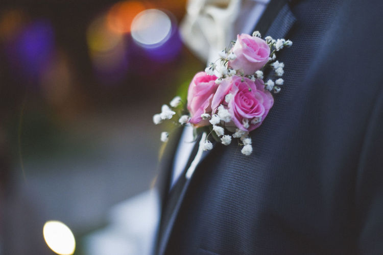 Close-up of pink flower corsage