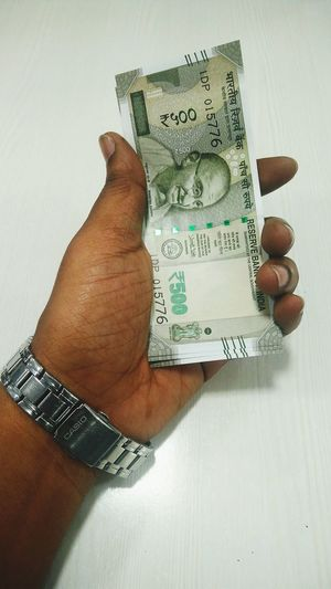 Paper Currency Finance Human Body Part Adults Only Currency One Person People Investment Human Hand Business Finance And Industry Adult Close-up Savings Deminitization New Currency 500 Rupees Rupee