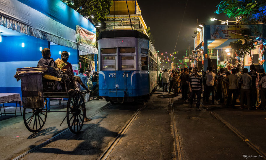 A bustling Kolkata street! Has all the unique city elements! :D Streetphotography Tram Tramway Kolkata India Kolkatacity Kolkatadiaries Rickshaw Tonga Puja Pandals Street Photography KolkataStreets